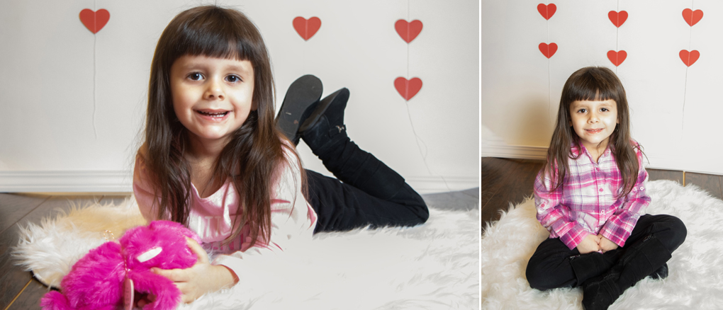 Valentines set with heart backdrop wood floor and rug.